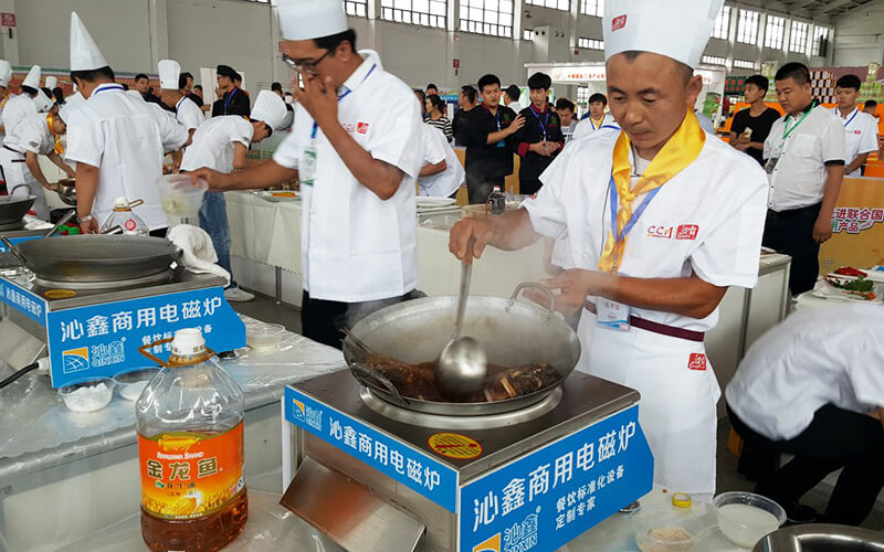 chefs are stir-frying with commercial induction stove